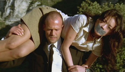 Shu Qi bound and gagged and thrown into the trunk of Jason Statham\'s car in The Transporter
