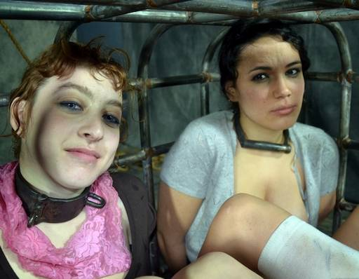 2 girls in a cage