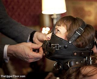 muzzled slave girl at The Upper Floor