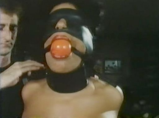 Vanessa del Rio blindfolded and wearing a ball gag