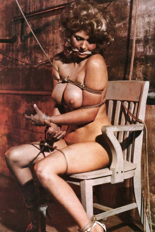 pretty girl with big tits tied to a wooden chair
