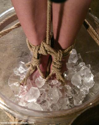 tied with her feet in a bowl of ice