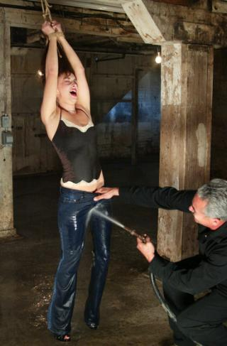 girl in bondage getting her jeans soaked