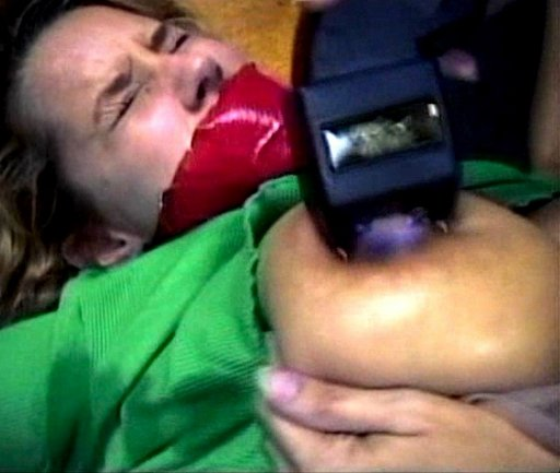 shocking the breast of a gagged girl with a stun gun