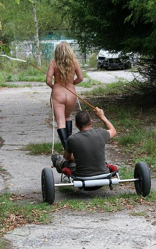whipped slavegirl towing a buggy