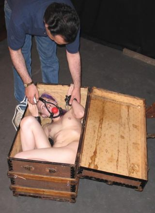 girl tied in a bondage trunk