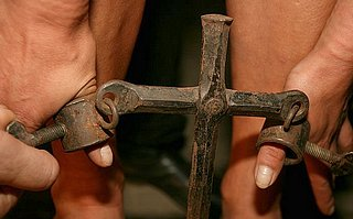 medieval thumbscrews to hold a woman bent over on the whipping block