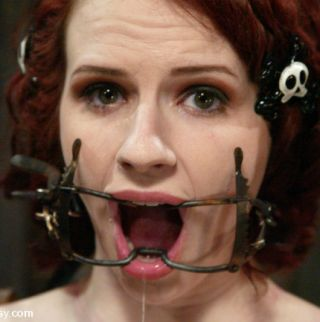 bondage model claire adams in a mouth gag