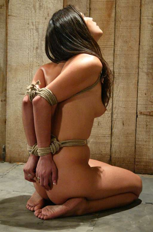 tightly tied elbows on a kneeling slave girl