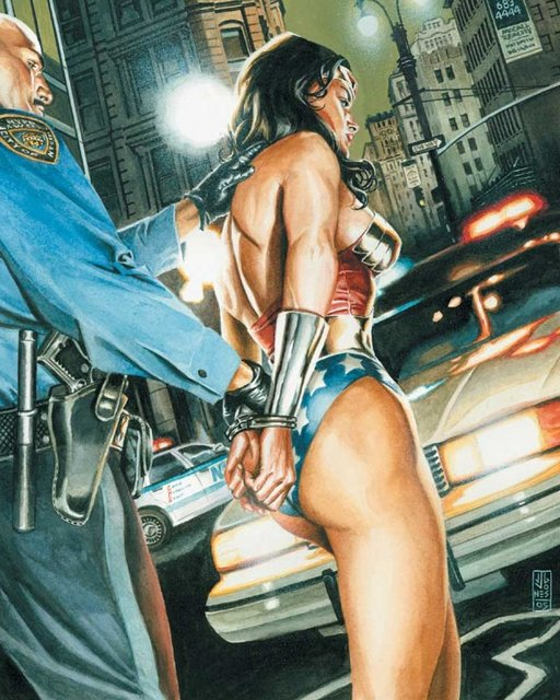 cop with wonder woman in handcuffs