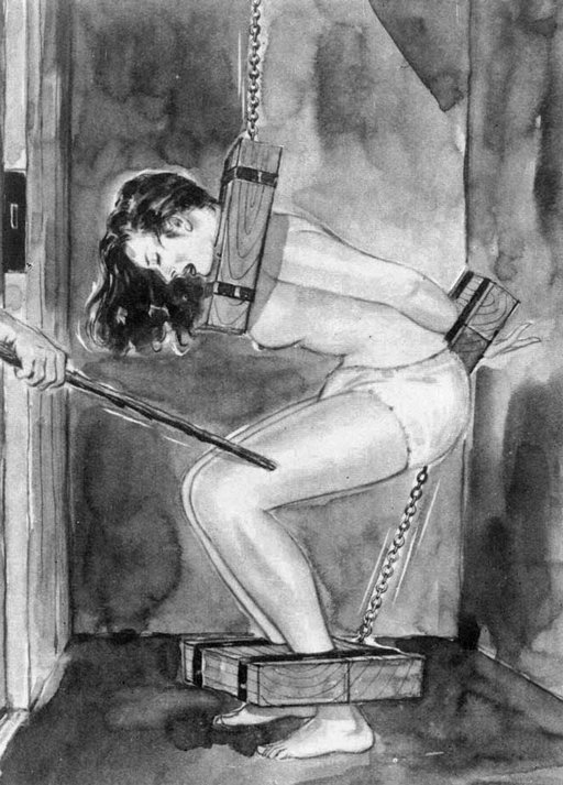 pain closet with wooden restraints and a stick beating