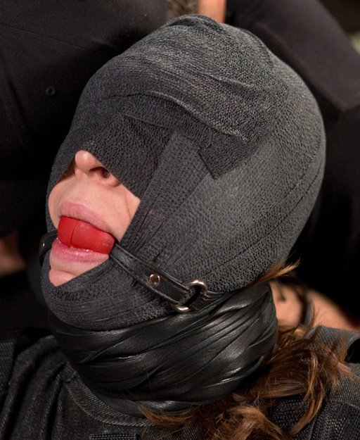 wrapped in sports wrap and gagged